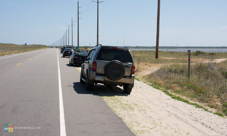 Cars line NC-12 at Canadian Hole, South of Haulover
